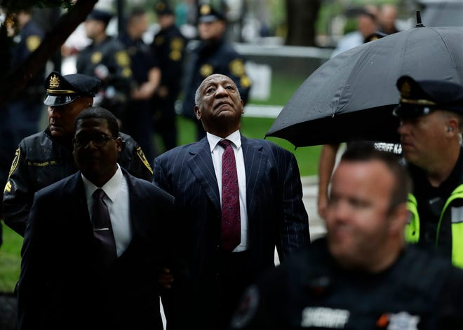 Bill Cosby arrives on a rainy Tuesday morning for the second day of his sentencing hearing at Montgomery County Courthouse in Pennsylvania.