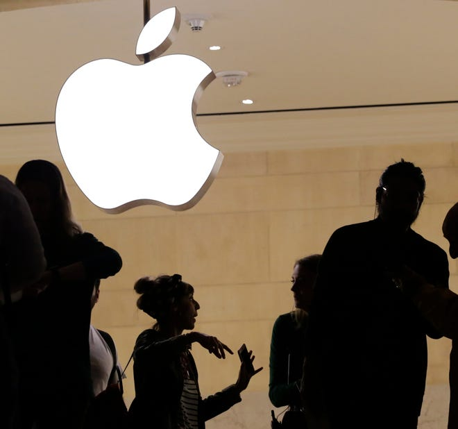 In this May 31, 2018, file photo customers enter the Apple store in New York.