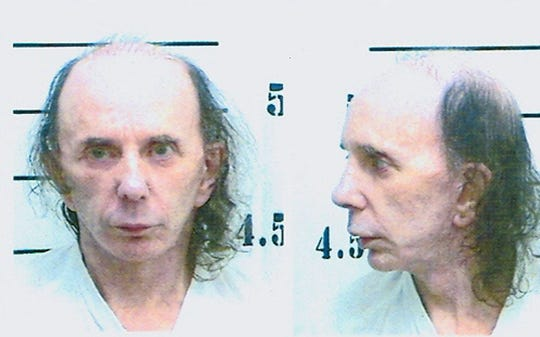 Phil Spector poses for his mugshot photo on June 5, 2009, at North Kern State Prison in Delano, California.