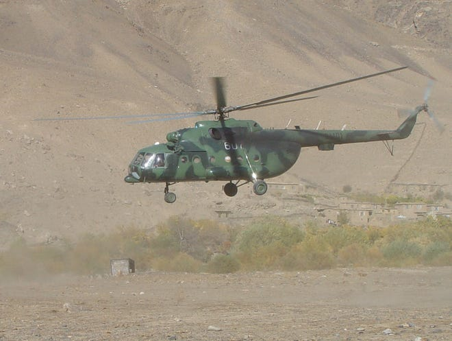 The Mi-17 used by the CIA to land its first team in Afghanistan after 9/11 is seen taking off in the Panjshir Valley in a photo taken between October 2001 and December 2001.