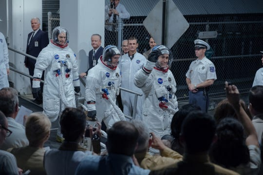 (L to R, Foreground): COREY STOLL as Buzz Aldrin, LUKAS HAAS as Mike Collins and RYAN GOSLING as Neil Armstrong in FIRST MAN. On the heels of their six-time Academy Award®-winning smash, La La Land, Oscar®-winning director Damien Chazelle and star RYAN GOSLING reteam for Universal Pictures' First Man, the riveting story of NASA's mission to land a man on the moon, focusing on Neil Armstrong and the years 1961-1969.