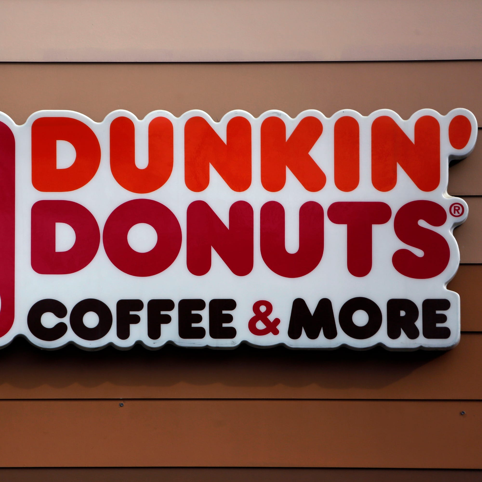 A Dunkin' Donuts logo is pictured on a shop in Mount Lebanon, Pennsylvania.