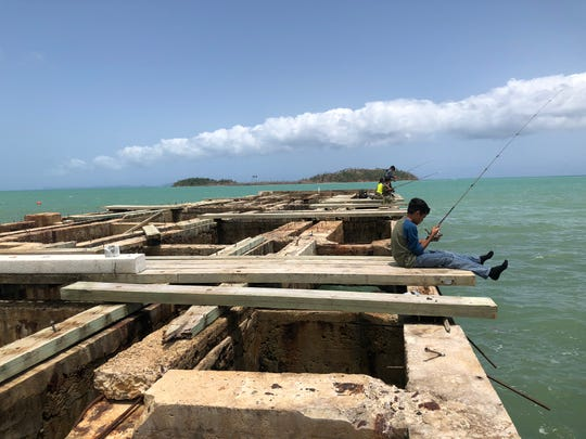 The fishing pier in Punta Santiago, Puerto Rico, was once the hub of local activity. Today, it sits in splinters, unfixed from Hurricane Maria.