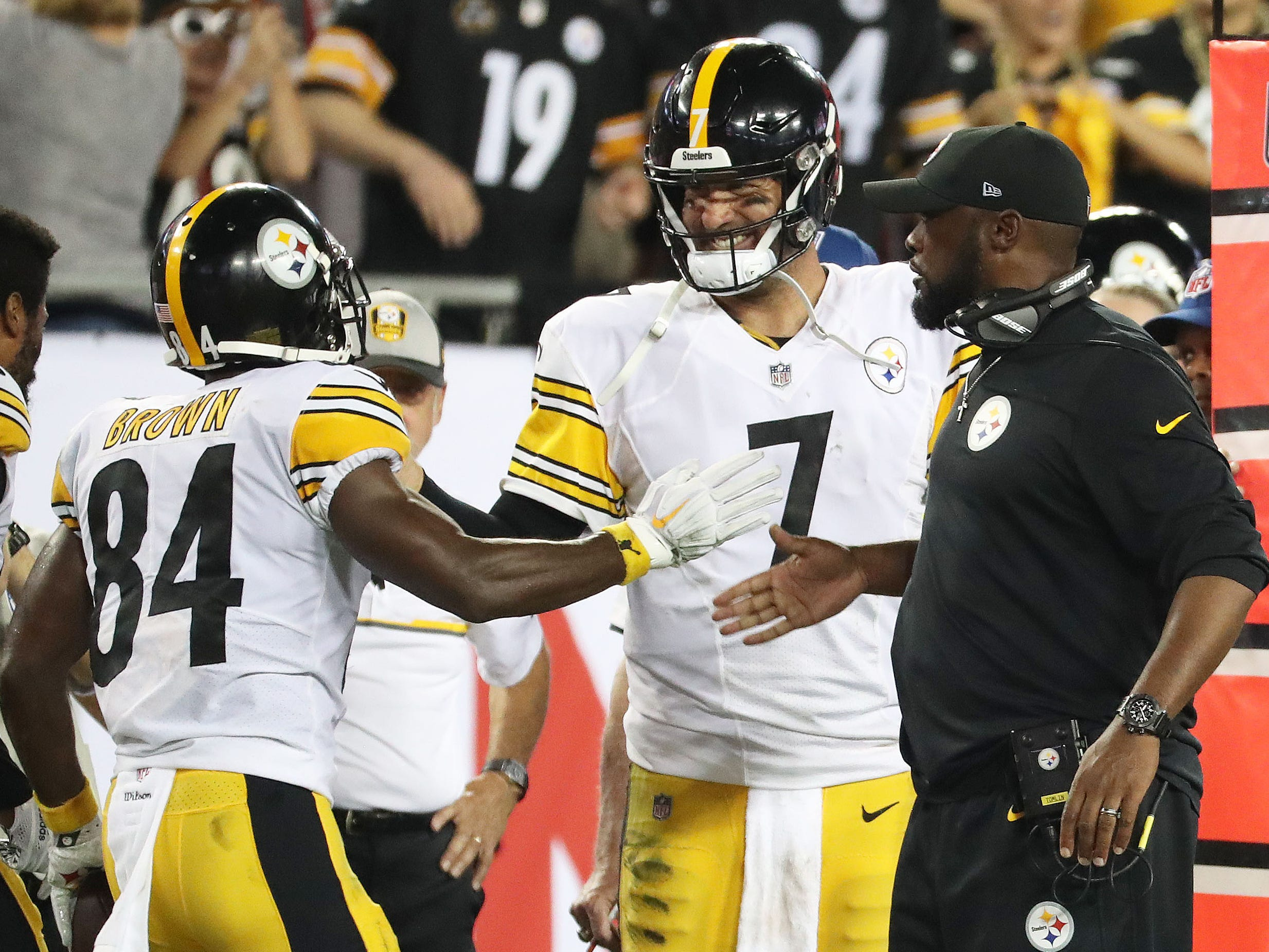 Steelers WR Antonio Brown (84) celebrates with QB Ben Roethlisberger (7) and head coach Mike Tomlin after scoring against Tampa Bay on Monday night.