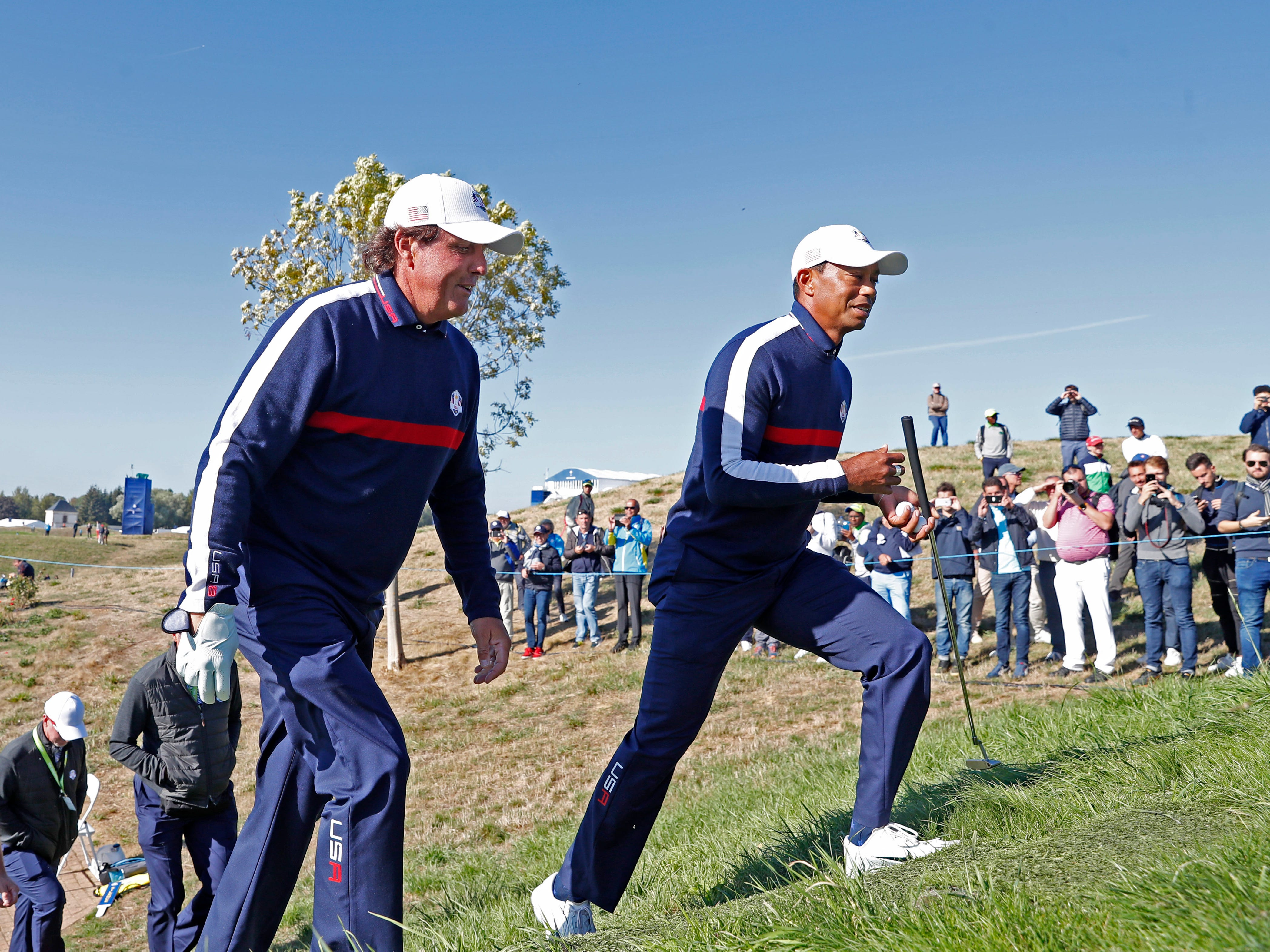 USA golfers Phil Mickelson and Tiger Woods walk to the 7th tee during a Ryder Cup practice round.