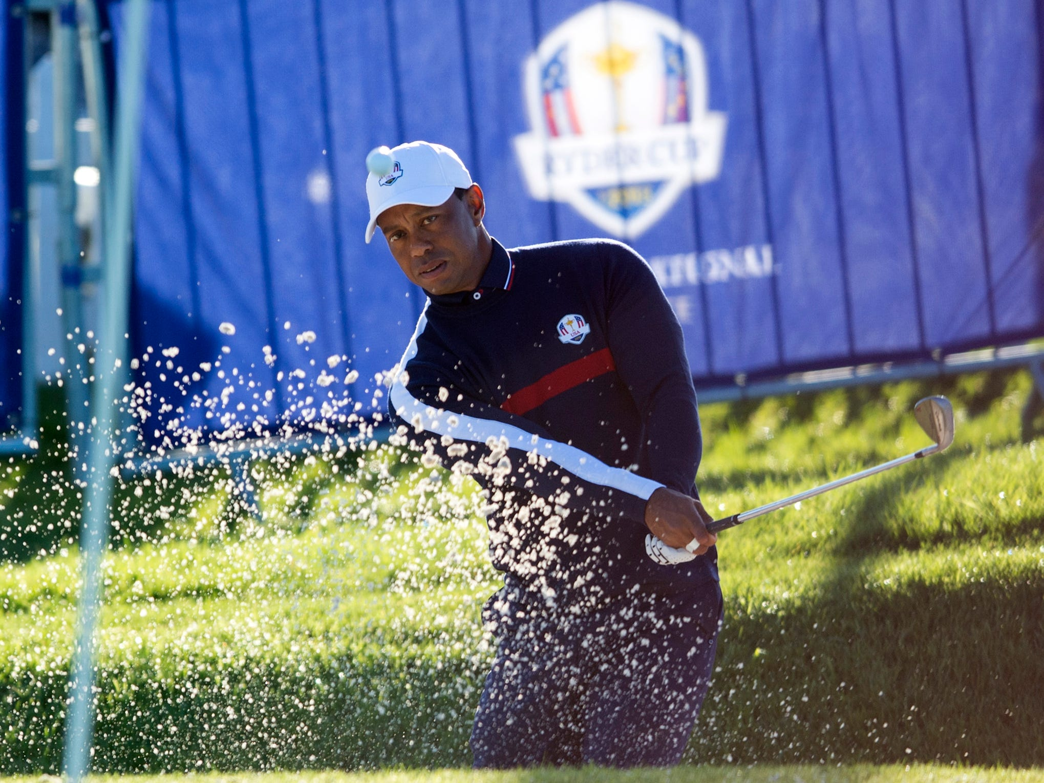 Tiger Woods plays from a bunker in the practice area during a Ryder Cup practice round.