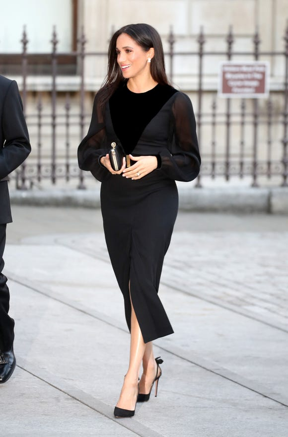 Duchess Meghan opted for a Givenchy ensemble for her first solo outing.