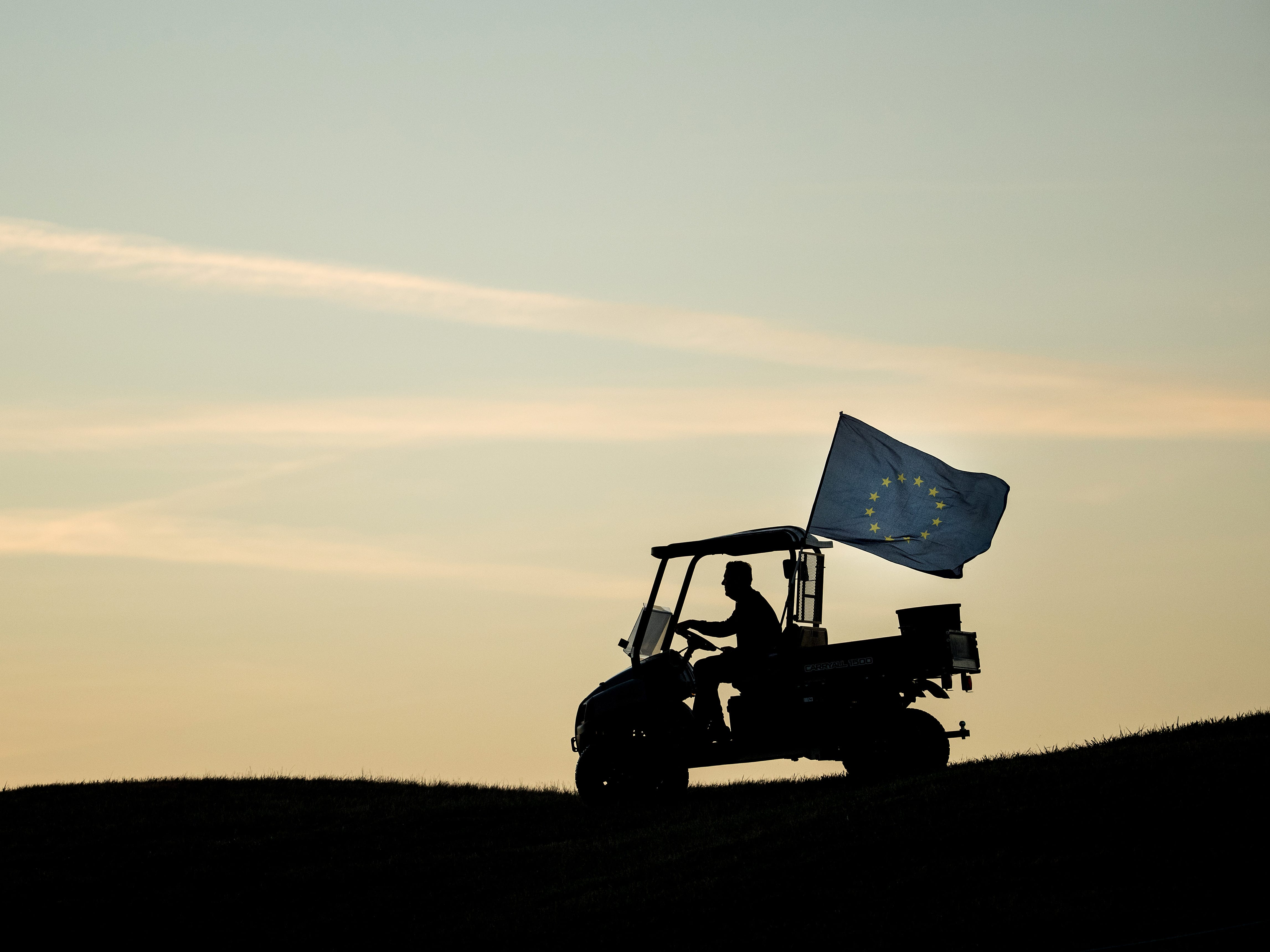 A buggy drives along with a European Flag flying ahead of the 2018 Ryder Cup.