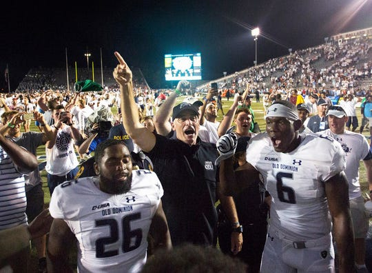Old Dominion coach Bobby Wilder celebrates with his team after beating No. 10 Virginia Tech.
