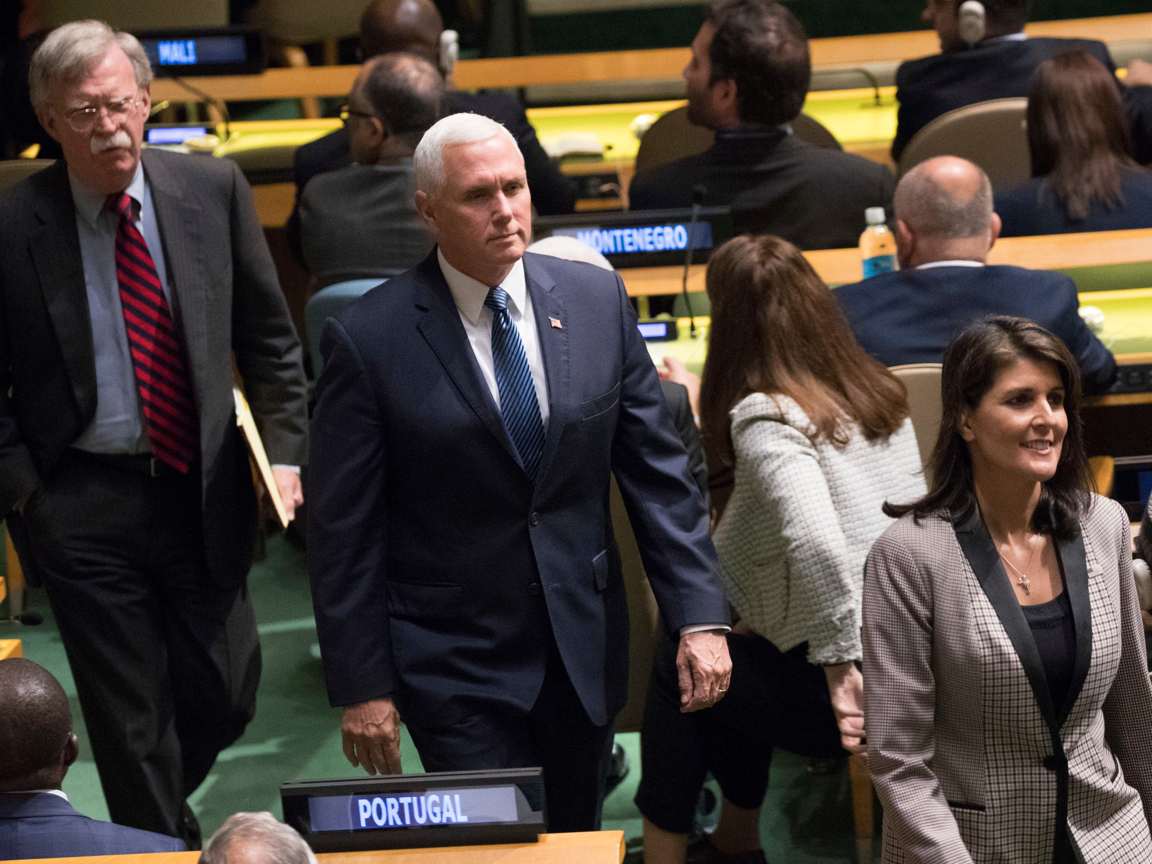 National security adviser John Bolton, left, Vice President Mike Pence, center, and Nikki Haley, the U.S. ambassador to the United Nations, arrive ahead of President Donald Trump's address to the 73rd session of the United Nations General Assembly, Tuesday, Sept. 25, 2018 at U.N. headquarters.