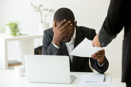 Frustrated Upset African American Employee Receiving Dismissal Notice At Workplace