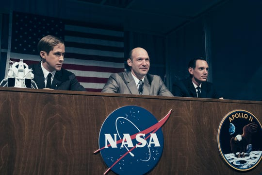 "Neil Armstrong (Ryan Gosling, from left), Buzz Aldrin (Corey Stoll) and Mike Collins (Lukas Haas) meet the press before their historic 1969 lunar mission in ""First Man."""