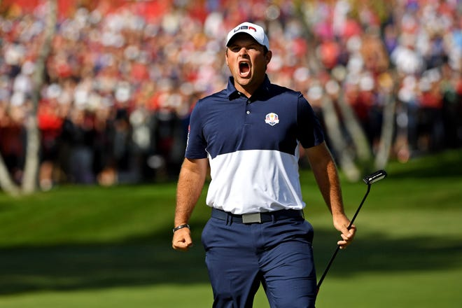 Patrick Reed of the United States reacts to a putt on the first green during the single matches in 41st Ryder Cup Hazeltine National Golf Club.