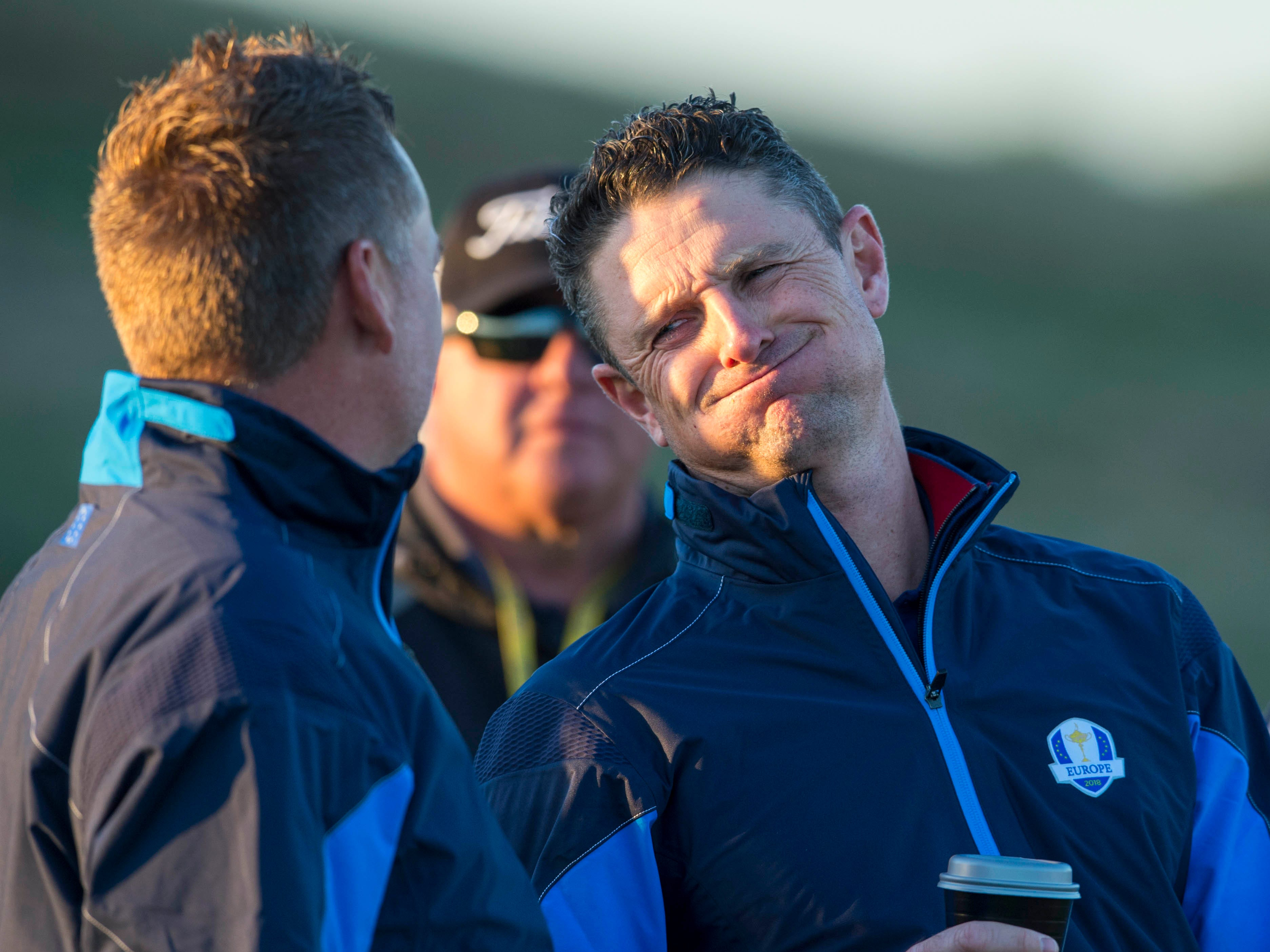 Justin Rose reacts with Ian Poulter during the European team photograph session before a Ryder Cup practice round.