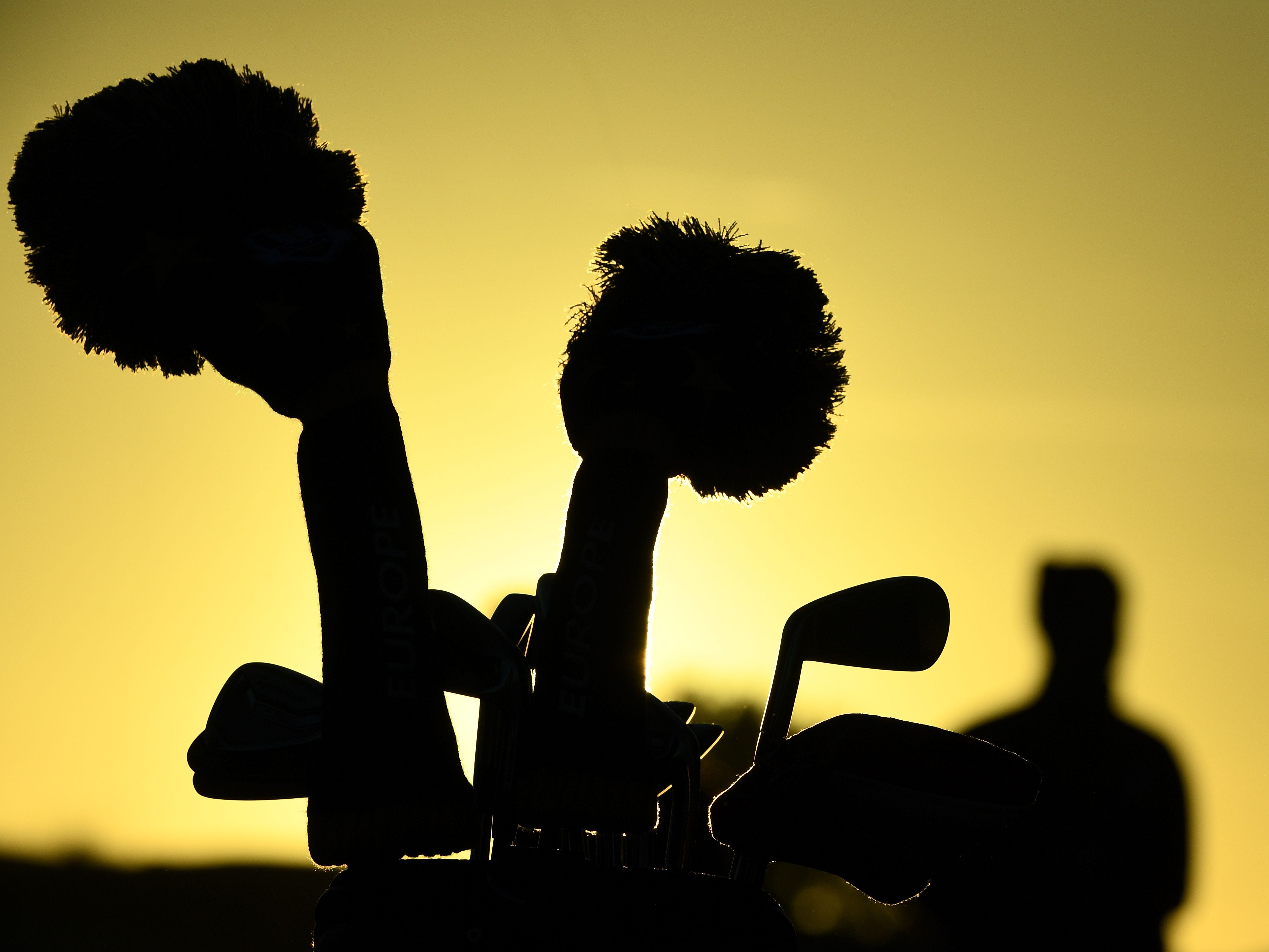 Golf clubs seen against the sun during a practice session ahead of the 42nd Ryder Cup at Le Golf National Course at Saint-Quentin-en-Yvelines, south-west of Paris.