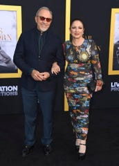 """Emilio and Gloria Estefan arrive Sept. 24, 2018, for the Los Angeles premiere of """"A Star Is Born"""" at the Shrine Auditorium. On Wednesday, Estefan Enterprises, with it partner CVS Health, announced it will match displaced workers at Estefan-owned establishments with jobs."""