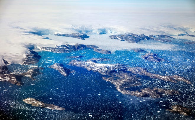 In this Aug. 3, 2017 file photo, icebergs float in a fjord after calving off from glaciers on the Greenland ice sheet in southeastern Greenland.