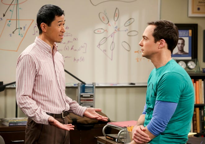 "Tam (Robert Wu, left) encounters a none-too-pleased Sheldon (Jim Parsons), his boyhood friend on ""Young Sheldon,"" in CBS'  ""The Big Bang Theory."""