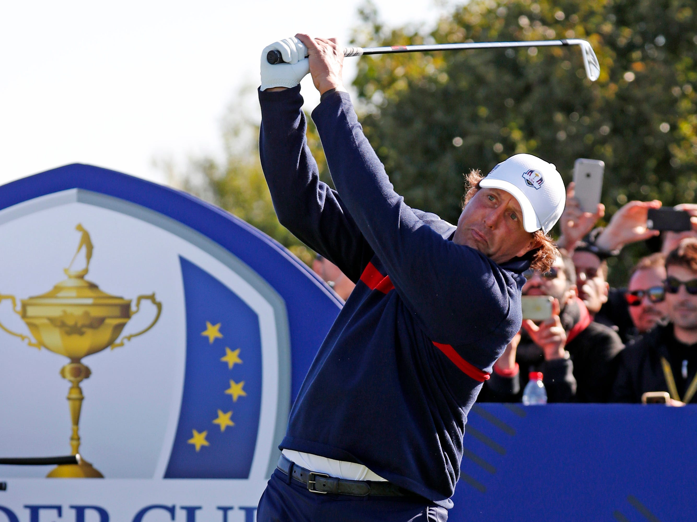USA golfer Phil Mickelson tees off on the eighth hole during a Ryder Cup practice round.