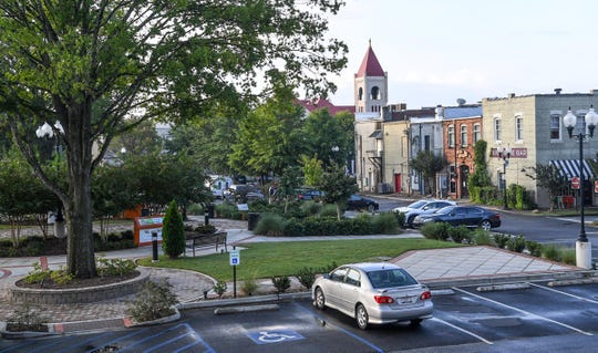 The Church Street Heritage Plaza in downtown Anderson was added to the parking lot made in 1980. Several business buildings on Church Street that were once thriving, were demolished and became a large parking lot next to city hall.