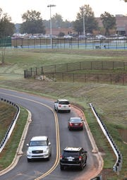 Cars come and go from Powdersville Middle School in September on the backside of the school, a new road to help reduce congestion from Hood Road on the front side of the school. The pickup and drop-off circle is considered one of the most congested among schools in Anderson County School District One, and with the new road to enter on the backside, one-third of the congestion has been reduced say parents and officials.