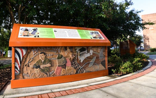 Art sculptures and information boards in the Church Street Heritage Plaza in Anderson.