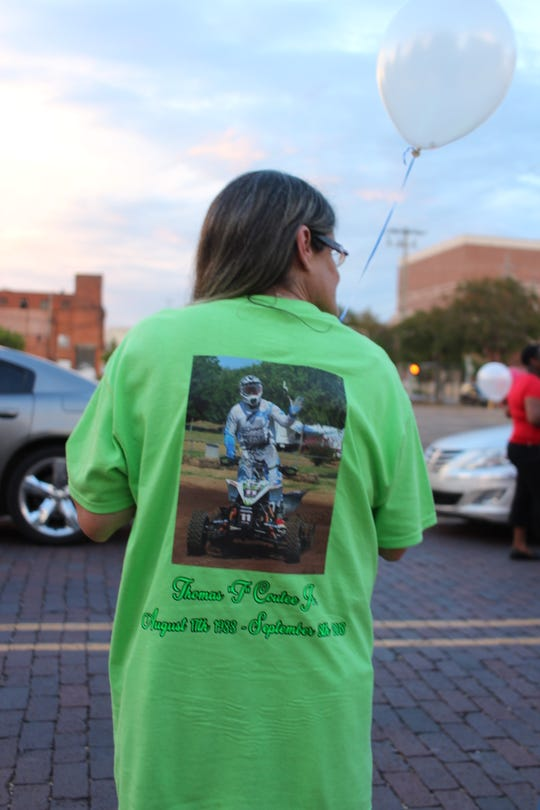 Cathy Pearson, the mother of homicide victim Thomas Coutee Jr., wears a T-shirt in his honor at the 3rd annual National Day of Remembrance for Murder Victims in downtown Alexandria in September 2018. The Rapides Parish District Attorney's Office was granted a recusal from prosecuting the case Monday because DA Phillip Terrell represented her ex-husband, Thomas Coutee Sr., in their separation case in 1990.