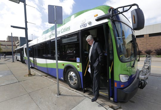 Mayor Tim Hanna exits a new 2017 New Flyer Excelsior heavy duty transit bus Wednesday prior to a press conference at the bus station in Appleton. (Dan Powers/USA TODAY NETWORK-Wisconsin)