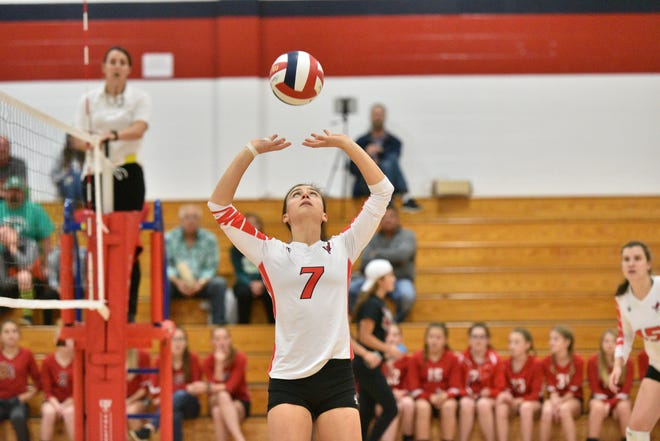 Pacelli's Karah Kluck sets the ball for a teammate. Kluck reached 2,000 career sets in the match against Almond-Bancroft on Tuesday, Sept. 25, 2018.