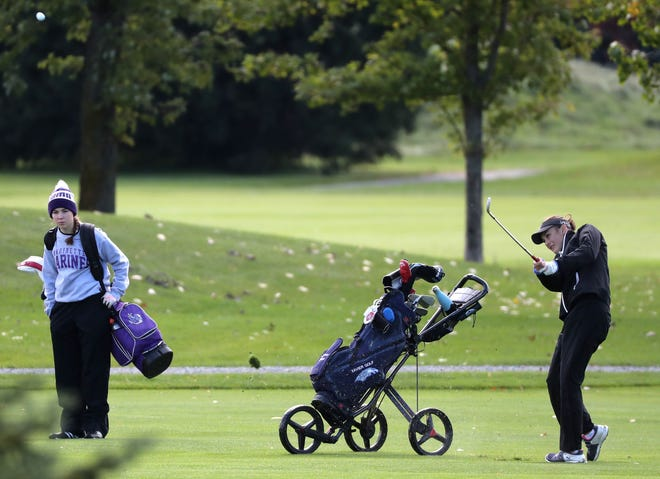 Xavier's Lauren Haen sends her ball to the green during the WIAA Division 2 girls golf regional Sept. 26 at Mid Vallee Golf Course in De Pere. Danny Damiani/USA TODAY NETWORK-Wisconsin