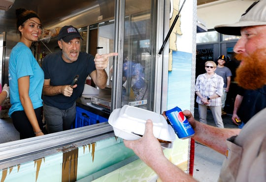 Morgan Olejarz and Jon Stewart take lunch order from construction workers and staff at Count Basie Center of the Arts in Red Bank,N.J. 