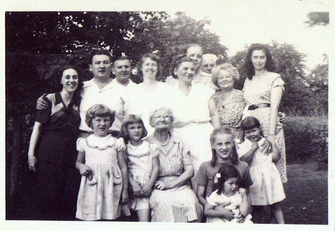 A gathering of the Keating family in 1948. Joyce Steinert Keating is the little girl in front, with the bow.