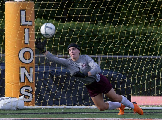 Red Bank goalie Addy McCarthy chases ball in front of her goal that goes wide during first half acton. Red Bank Girls soccer vs Middletown North in Middletown NJ on September 26, 2018.