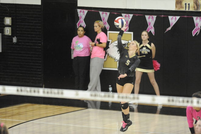 Allison Pierce hits in a serve during Abilene High's win over Haltom High on Sept. 25. On Friday against San Angelo Central, Pierce had a great floor game with 15 assists and 19 digs.