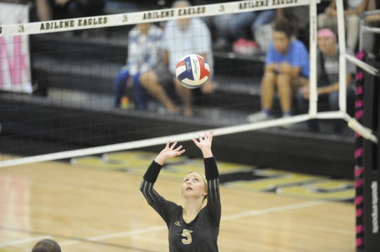 Allison Pierce bumps a set to a teammate during Abilene High's win over Haltom High Tuesday Sept. 25, 2018.