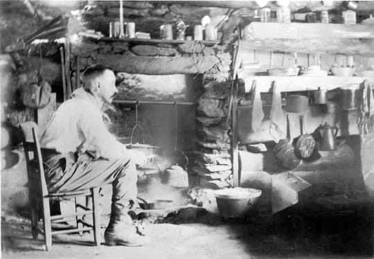 Horace Kephart in his cabin in what became Great Smoky Mountains National Park, about 100 years ago.