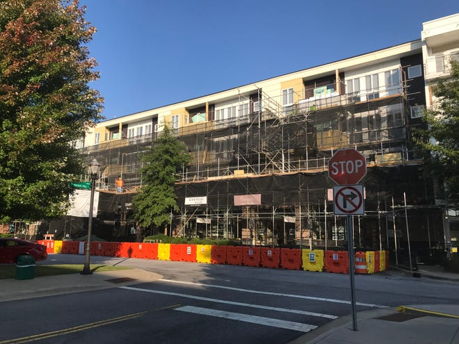 Some of the apartment balconies in Biltmore Park's Town Square area need repair work or replacement, which explains the three-story high scaffolding in places.