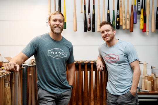 Young Bat Company owners Tom Young, left, and Cody Siniard in Fletcher Sept. 11, 2018.