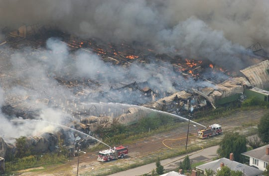 An aerial photo of the Beacon Manufacturing plant in Swannanoa  burning in September 2003.