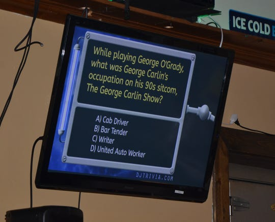 A multiple-choice question appears on a screen during a game of  DJ Trivia at Strikers Sports Bar on Tuesday, September 25, 2018.