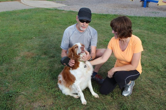 Dr. Gary Ellis, a local veterinarian,  his wife, Patti Ellis, and their dog Toby.