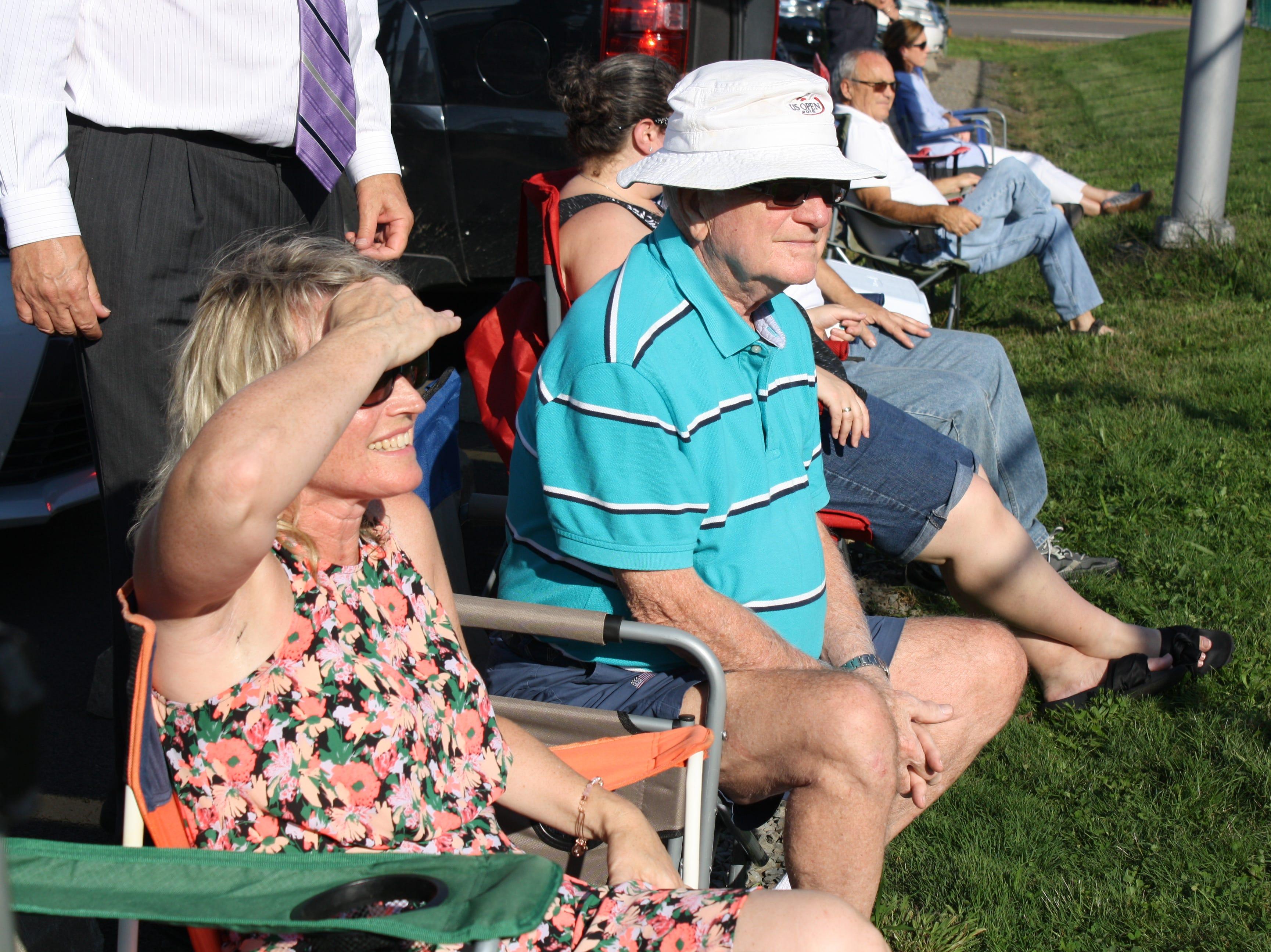 Julia Miller and her father, Joe McCann, cheer on Seton Catholic High School junior Julianna Miller, 16, as she competes in a singles tennis match against Windsor's girls varsity tennis team on Sept. 18.