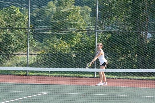 Seton Catholic High School junior Julianna Miller, 16, winds up to serve during a singles tennis match against Windsor's girls varsity tennis team on Sept. 18.