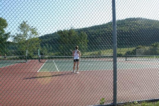 Seton Catholic High School junior Julianna Miller, 16, competes in a singles tennis match against Windsor's girls varsity tennis team on Sept. 18.
