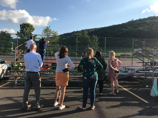 Seton Catholic Central High School parents look on during a girl's varsity tennis match at Windsor High School on Sept. 18.