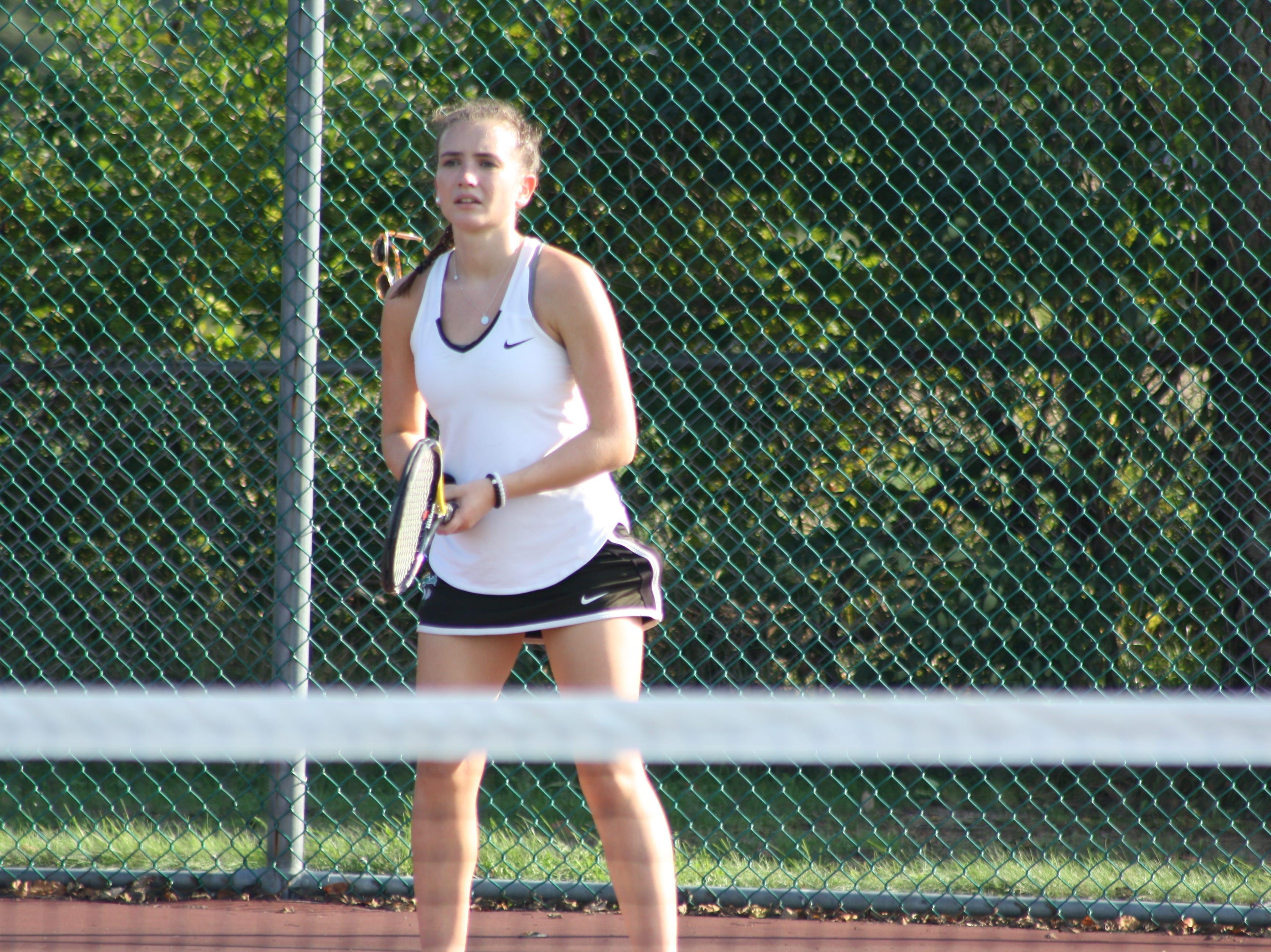 Seton Catholic High School junior Julianna Miller, 16, competes in a tennis match against Windsor's varsity girl's tennis team on Sept. 18.