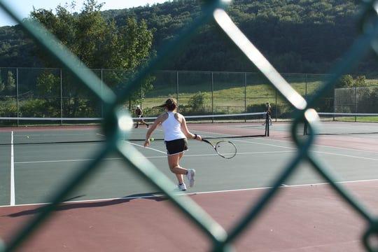 Seton Catholic High School junior Julianna Miller, 16, competes in a singles tennis match at Windsor High School on Sept. 18.