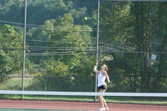 Seton Catholic High School junior Julianna Miller, 16, prepares to serve during a singles tennis match against Windsor's girls varsity tennis team on Sept. 18.