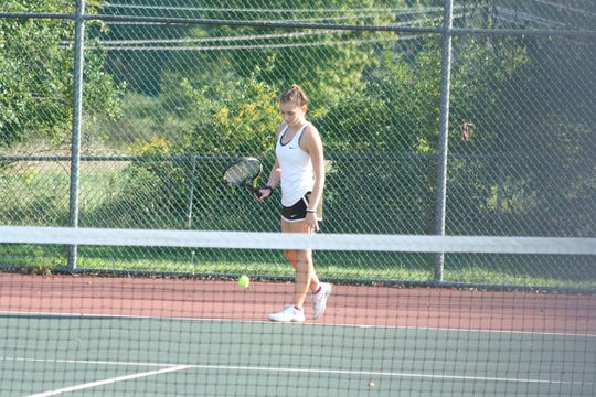 Seton Catholic High School junior Julianna Miller, 16, competes in a singles tennis match against at Windsor High School's tennis courts on Sept. 18.