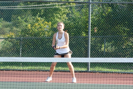 Seton Catholic High School junior Julianna Miller, 16, was taught to play tennis by her grandmother.